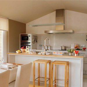 Cocinas peque as alargadas el m ximo provecho dise o for Cocina y lavadero integrados